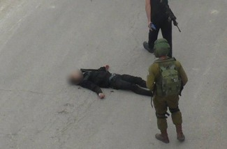 Al-Sharif lying murdered on the ground (PNN image)