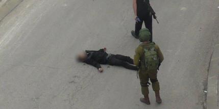 Al-Sharif lying murdered on the ground (PNN image)
