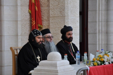 Archbishop Sewerios Malki Murad, right, speaks during a graduation ceremony for Syriac Christian students in Bethlehem on July 1, 2015. (MaanImages/ Emily Mulder, File)