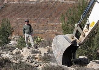 Israeli bulldozer with settler standing nearby (Maan)