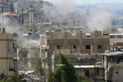 Smoke billows in the Ain al-Helweh Palestinian refugee camp near Sidon, Lebanon, on August 23, 2015. (AFP/Mahmoud Zayyat/File)