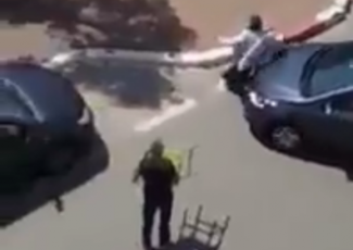 Image from video of Israeli driver hitting alleged assailant with car (from Shehab news agency)