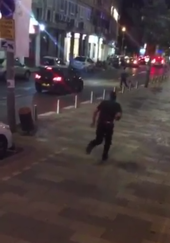 Officer after firing shots (image from Twitter)