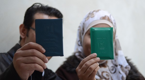 Couple with different ID cards (image by PNN)