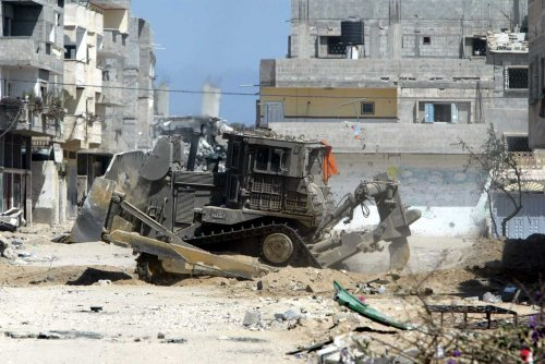 Caterpillar armored bulldozer demolishing home (file image from ICAHD)