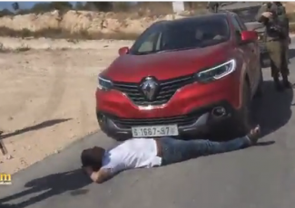 Mohammad Khatib lying in front of his car (image by Haitham Khatib)