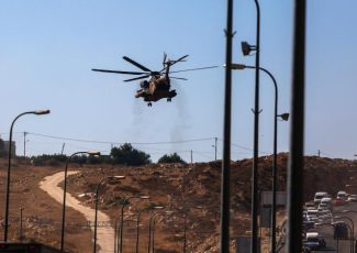 Israeli helicopter over settlement of Shiloh (image from vosizneias.com)