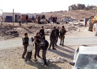 Israeli troops stop Palestinian man at checkpoint (PCHR photo)