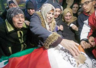Family mourns Mohammad Salhi, killed by Israeli forces in front of his mother (PCHR photo)