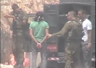 Shooting of handcuffed Palestinian (image from video by B'Tselem)