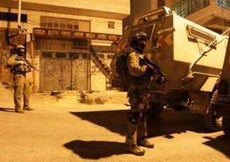 Israeli troops invading Palestinian town (PCHR image)