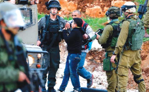 Child abducted by Israeli troops (PCHR photo)