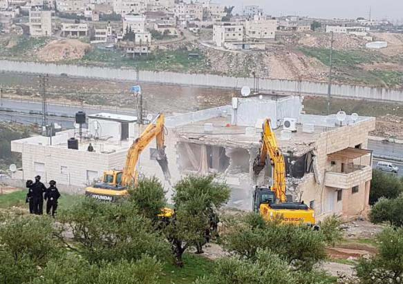 Home demolition by Israeli armored bulldozers (PCHR image)
