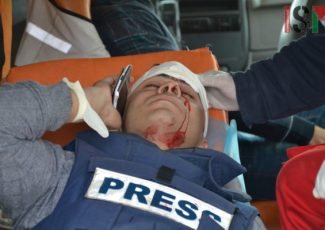 Journalist wounded in Kafr Qaddoum (image by ISM)
