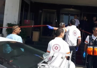 Scene outside hotel where stabbing took place (image from Ma'an)