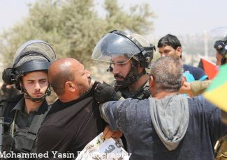 Bil'in abduction (image by Mohammed Yassin)