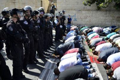 Noon prayers outside the al Aqsa mosque (image from Middle East Eye)
