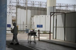 A staff member at the Erez Crossing between Israel and Gaza waits during the transfer of a 6-day-old baby from Gaza to a hospital in the city of Nablus in the occupied West Bank for medical treatment. Israeli authorities approved permits for medical appointments for only 54 percent of Palestinians seeking vital medical treatment outside of Gaza in 2017. © 2015 Medical Aid for Palestinians (MAP)