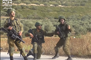 Soldiers cheer while shooting civilians (image from B'Tselem video)