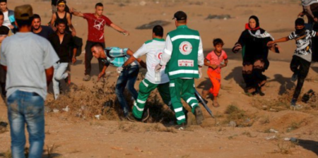 Medics rescue a wounded Palestinian at Gaza protest