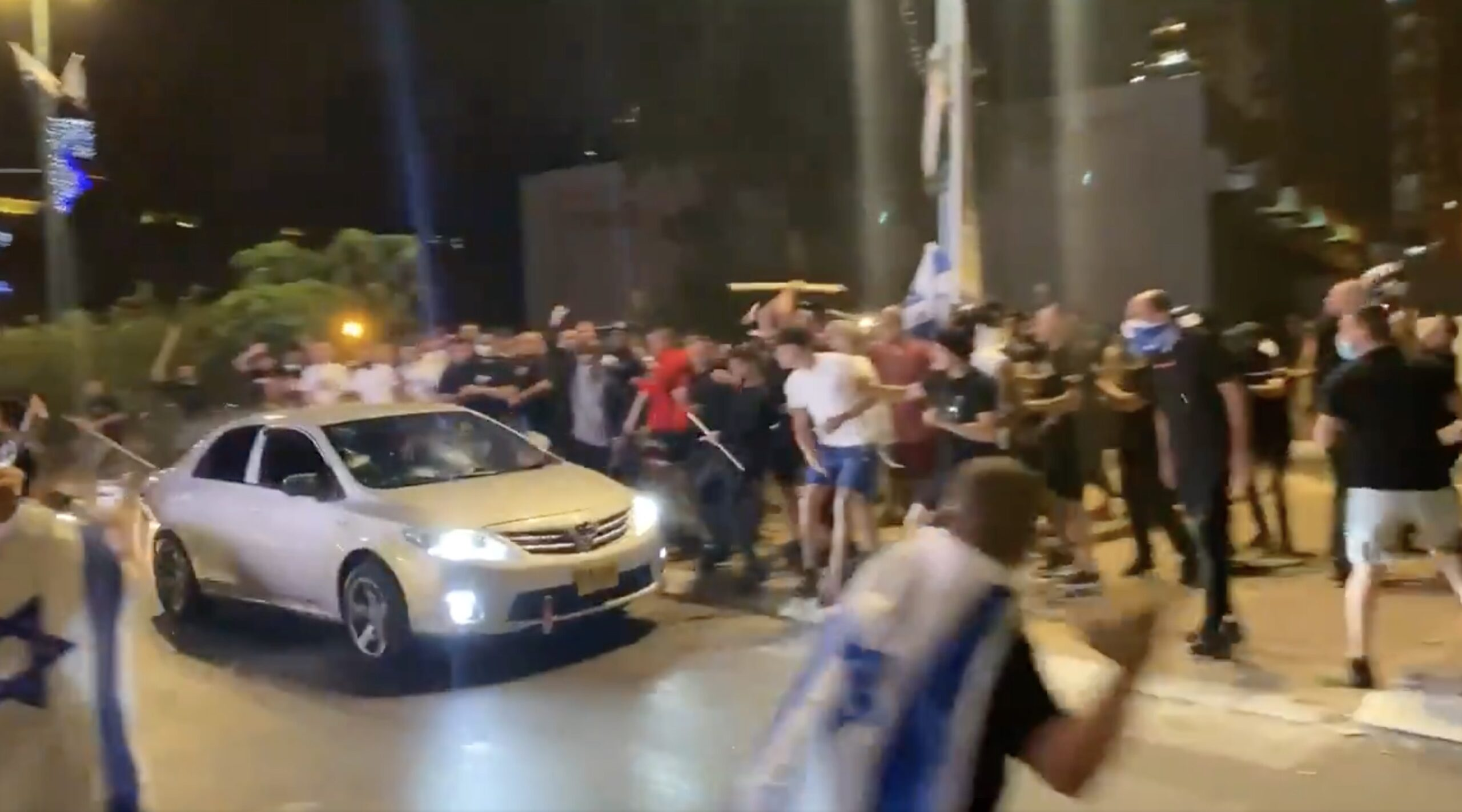 Screen Capture from video posted on Twitter depicting a violent right wing mob attacking a car they thought to be driven by a Palestinian. Posted by @Bar_Peleg