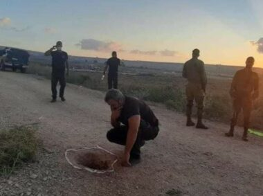 Israeli Officer examines the hole where the prisoners escaped
